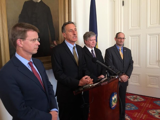 Gov. Peter Shumlin speaks, flanked by (l-r) House Speaker Shap Smith, Senate President Pro Tem John Campbell and Secretary of Administration Justin Johnson. - NANCY REMSEN