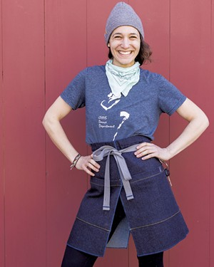 Rachel Stern modeling a KWBB gardening apron - HOMER HOROWITZ