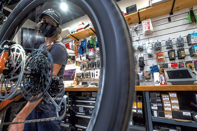 Shop manager Mar Kuhnel tuning a bike at Ranch Camp - JEB WALLACE-BRODEUR