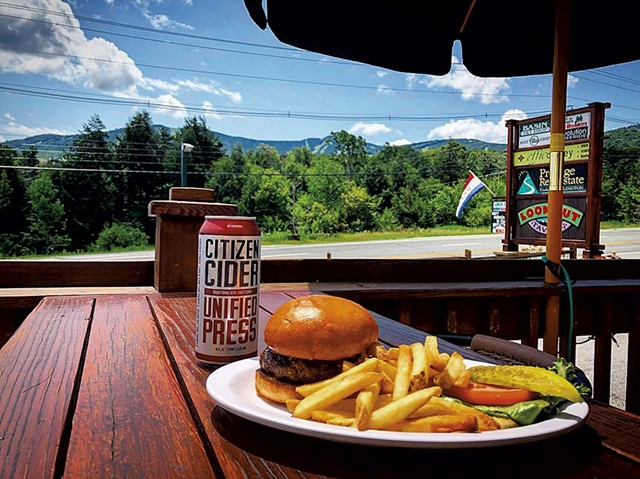 Burger and cider on the deck at Lookout Tavern - COURTESY OF PHIL BLACK