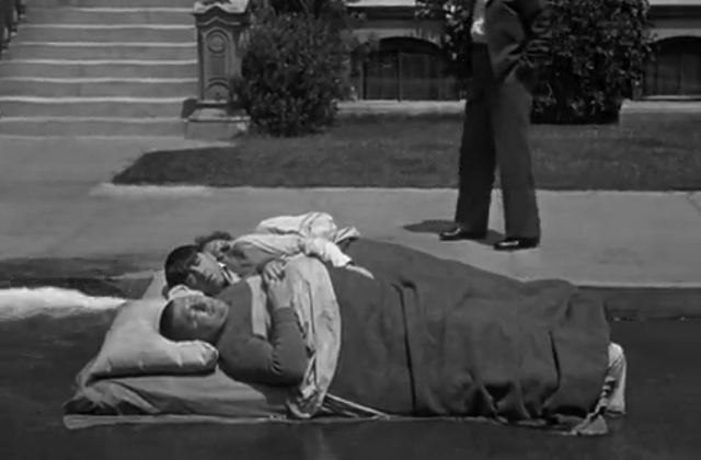 Gutter-sailing in a mattress, Stooge-style. - COLUMBIA PICTURES