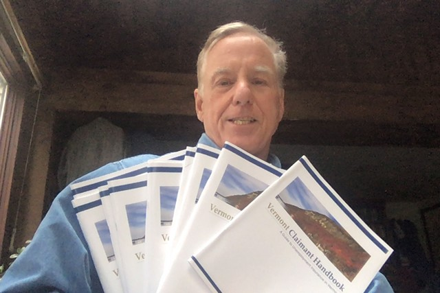 Former governor Howard Dean with multiple information booklets for new claimants that he received - COURTESY PHOTO: HOWARD DEAN