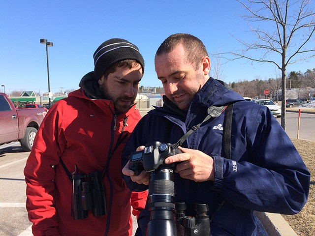 Taj Schottland (left) checking out bird photos with fellow birder Zac Cota - COURTESY OF MEGHAN OLIVER