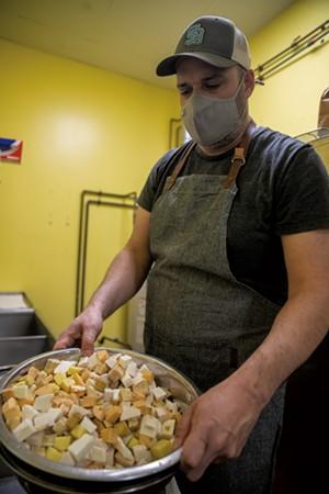 Oscar Arencibia preparing a Santiago's meal - JAMES BUCK