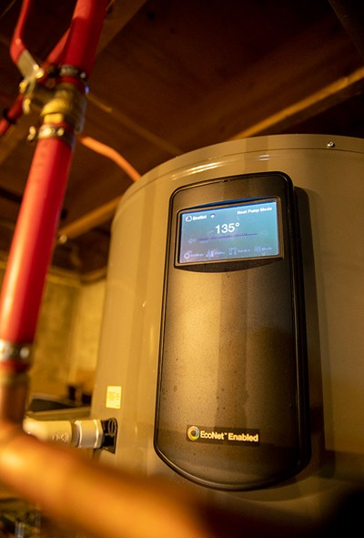 The heat pump water heater in the Fink's basement - JAMES BUCK