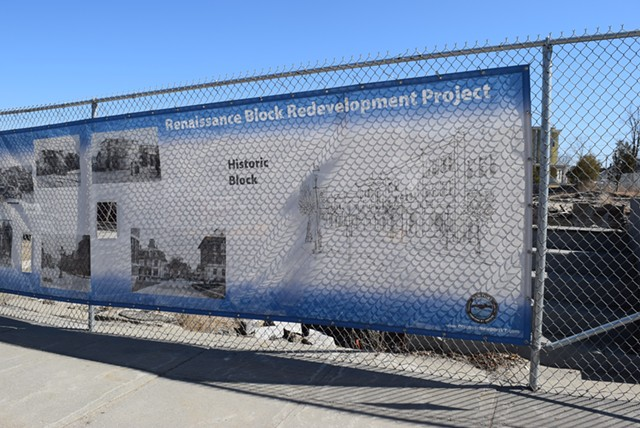 A sign touting the Renaissance Block project covers a fence on Main Street in Newport. - TERRI HALLENBECK