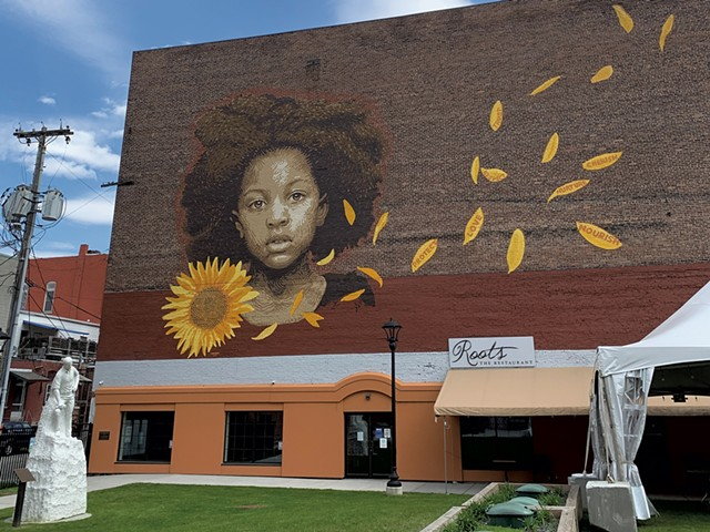 """""""We Who Believe in Freedom Cannot Rest Until It Comes"""" mural by LMNOPI at Center Street Marketplace Park - SOPHIE X. POLLAK"""