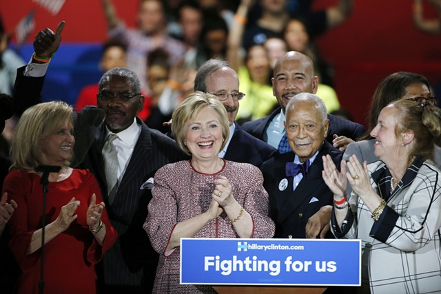 Flanked by supporters, including former New York Mayor David Dinkins, Democratic presidential candidate Hillary Clinton celebrates after winning the New York primary election. - AP PHOTO/KATHY WILLENS