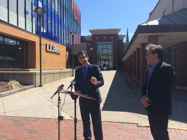 Mayor Miro Weinberger, left, and Don Sinex discuss their agreement with reporters outside the Burlington Town Center Wednesday. - ALICIA FREESE