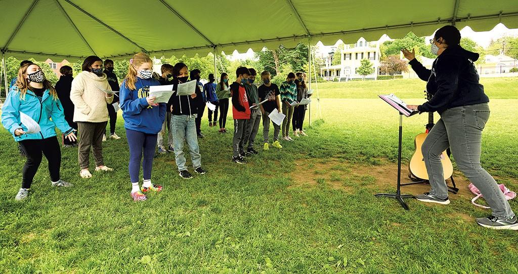 BetsyNolan leads a rehearsal in an outdoor classroom at Edmunds School in Burlington - BEAR CIERI