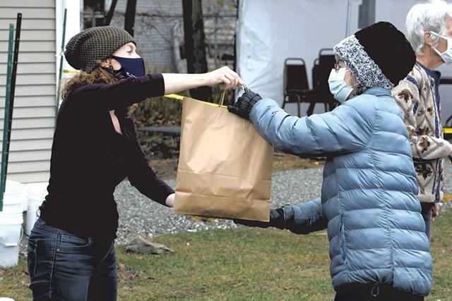 A Heineberg volunteer delivering a meal - COURTESY