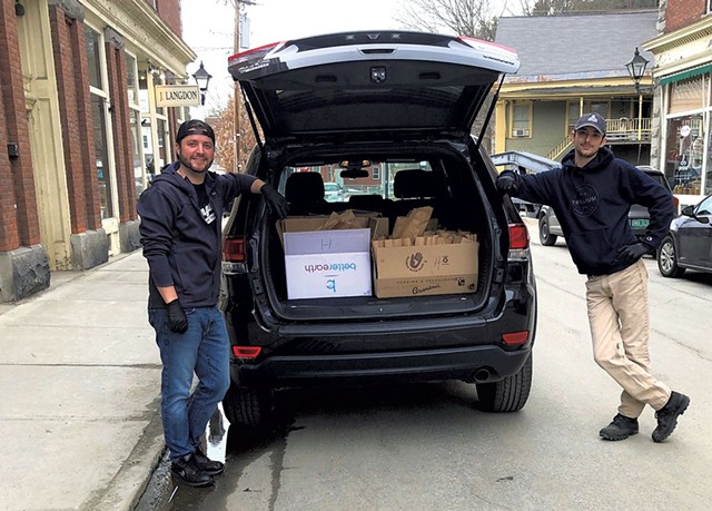 David Thomas (left) of Langdon Street Tavern and Nathan Magne of Union Mutual preparing to deliver meals - COURTESY