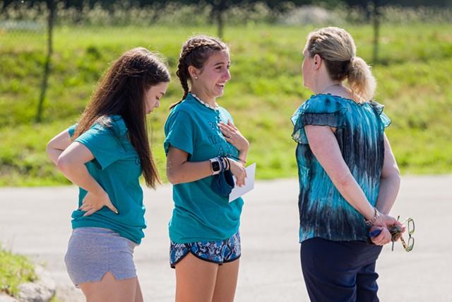 Maddie Goddard and Hannah Sheppard speak to Rice Principal Lisa Lorenz. - OLIVER PARINI