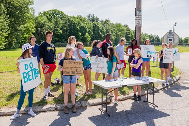 Students demonstrate near the entry to Rice Memorial High School in South Burlington. - OLIVER PARINI
