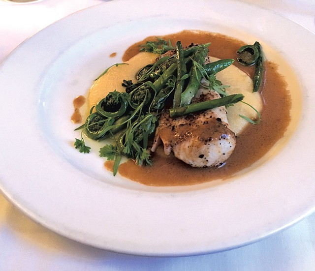Wahoo, fiddleheads and asparagus at the Kitchen Table Bistro - PAMELA POLSTON