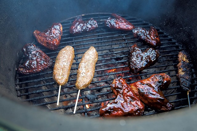 Chicken wings and kababs on the grill - JAMES BUCK