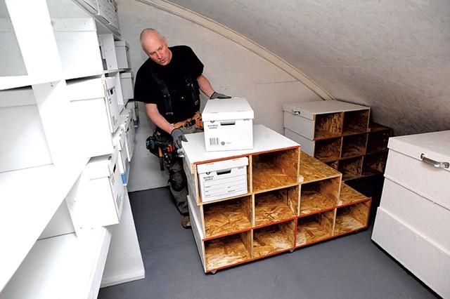 Tim Szad working on evidence storage racks - STEFAN HARD