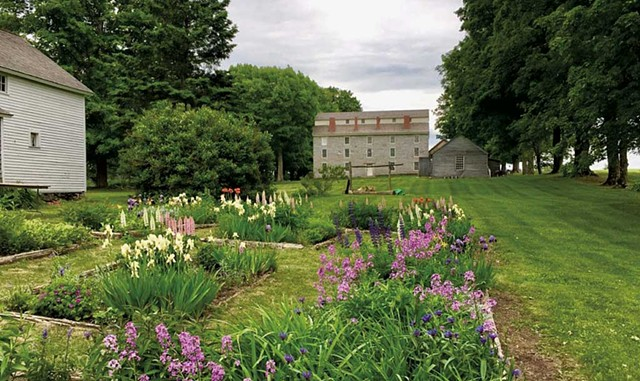 Gardens in front of the granite dormitory built by Alexander Twilight in the 1830s - COURTESY OF OLD STONE HOUSE MUSEUM