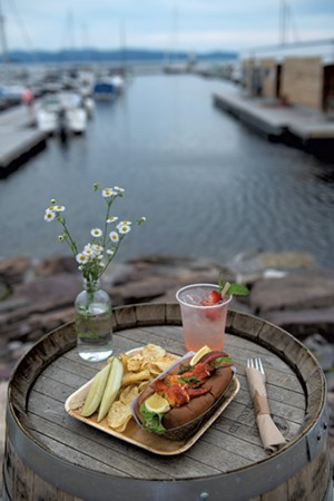 A lobster roll served with a strawberry-rhubarb gin and tonic - DARIA BISHOP