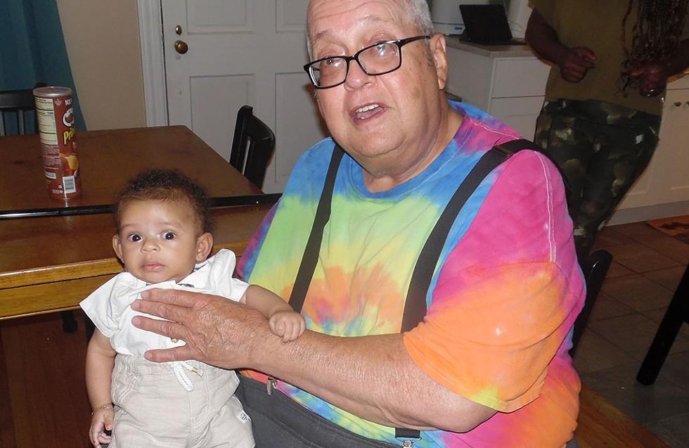 William Croteau holding his 28th grandchild - COURTESY IMAGE