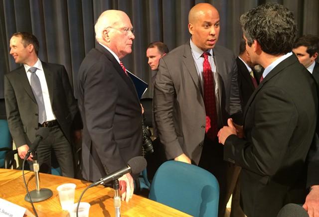 Sen. Cory Booker (D-N.J.) talks with Burlington Mayor Miro Weinberger as Sen. Patrick Leahy (D-Vt.) looks on. - MARK DAVIS