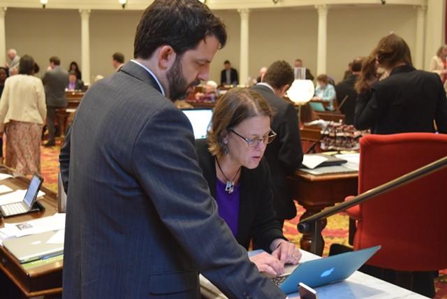 Reps. Chris Pearson (P-Burlington) and Kate Webb (D-Shelburne) discuss marijuana legislation during a break Tuesday. - TERRI HALLENBECK