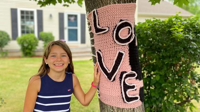 """Daniella D'Agostino with a """"love"""" wrap in Williston - COURTESY OF GRETA D'AGOSTINO"""