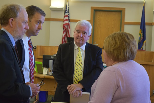David Williams and Brooks McArthur, attorneys for Sen. Norm McAllister, (left) talk with Franklin County State's Attorney Jim Hughes and Deputy State's Attorney Diane Wheeler. - TERRI HALLENBECK