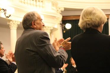 Sen. Dick Mazza applauds Lt. Gov. Phil Scott Friday night at the Statehouse.