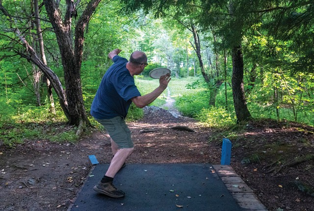 A disc golfer at Center Chains in Waterbury Center - JEB WALLACE-BRODEUR