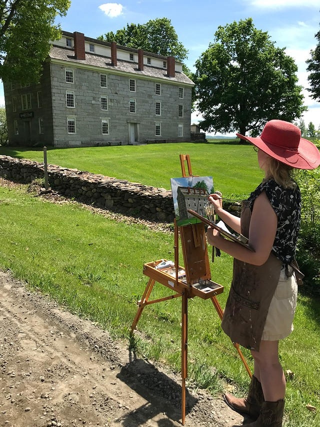 Artist Katie Runde painting the Old Stone House Museum - SALLY POLLAK ©️ SEVEN DAYS