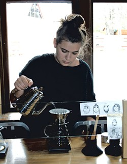 Camille Berlioz making a pour-over at Maglianero - SUZANNE PODHAIZER