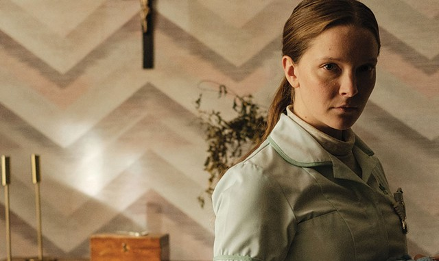 KEEPING THE FAITH Clark plays a young nurse convinced that God has a special plan for her in Glass' impressive debut. - COURTESY OF A24