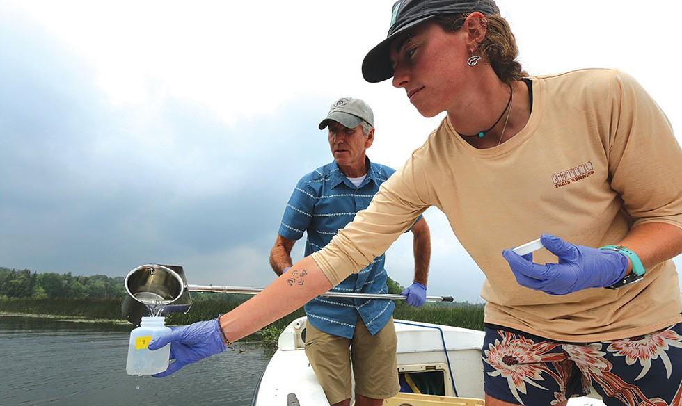 Rick Levey and Kelsey Colbert gathering water samples in Lake Memphremagog - KEVIN MCCALLUM ©️ SEVEN DAYS