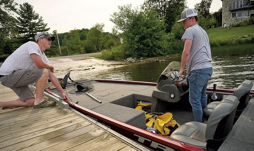 Brandon Grenier (left) and Noah Crogan preparing to go bass fishing on Lake Memphremagog - BEAR CIERI