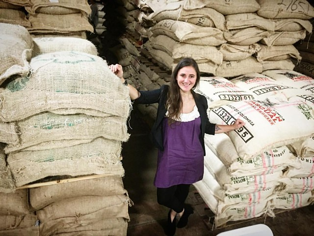 Magdelena Van Dusen with green coffee bags - COURTESY OF BRIO COFFEEWORKS
