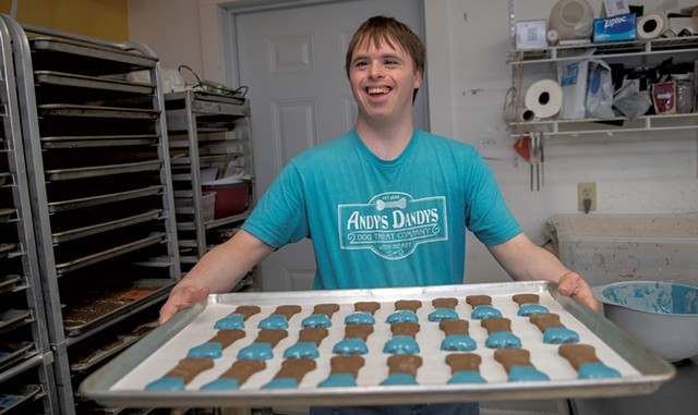 Co-owner Andrew Whiteford with a tray of dog treats - DARIA BISHOP