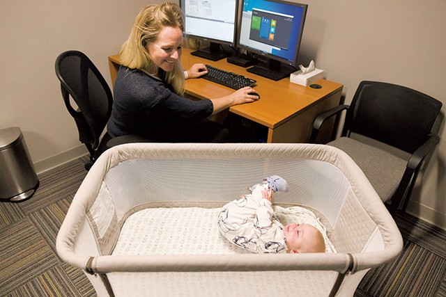 Jill Coombs and her daughter, Georgia, in the Babies at Work room at Twincraft's Winooski location - OLIVER PARINI