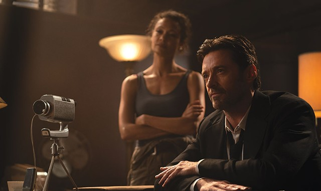 THANKS FOR THE MEMORIES Jackman sells people pieces of their own pasts in Joy's disappointing sci-fi noir. - COURTESY OF WARNER BROS. PICTURES