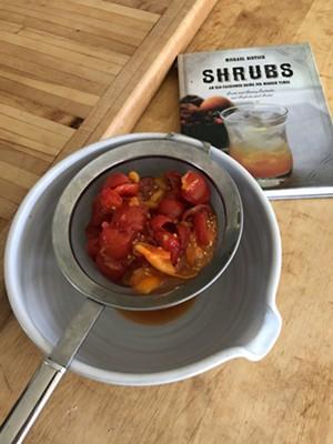 Tomatoes straining for shrub - JORDAN BARRY ©️ SEVEN DAYS