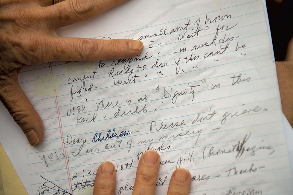 A daughter showing notes from her mother, who died last year while waiting to see a specialist at the University of Vermont Medical Center - DARIA BISHOP