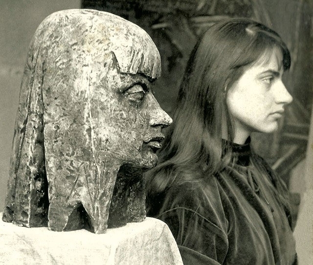 Elka Schumann standing beside a sculpture of her made by her future husband, Peter Schumann, in Hanover, Germany, in 1958 - COURTESY