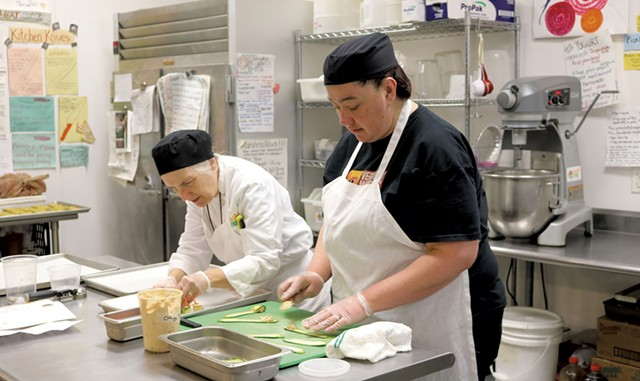 Chef-instructor Robin Burnett (left) and participant Stacey Clarke in the Vermont Works for Women Fresh Food Enterprise training program in 2015 - COURTESY OF VERMONT WORKS FOR WOMEN