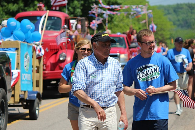 Gubernatorial candidate Bruce Lisman marches Monday in Vergennes' Memorial Day Parade. - PAUL HEINTZ