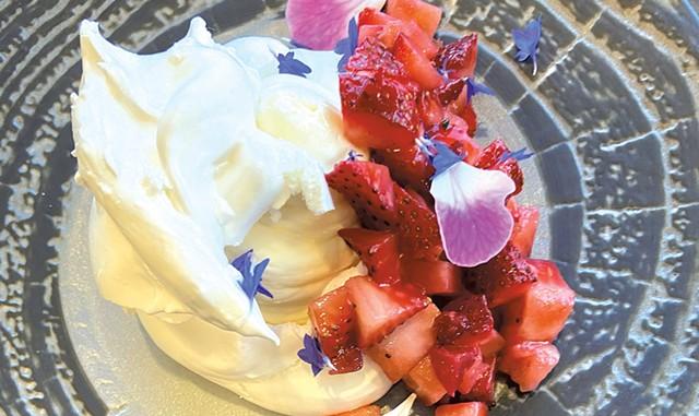 Pavlova with macerated strawberries, rose and geranium from bramble - COURTESY OF BRAMBLE