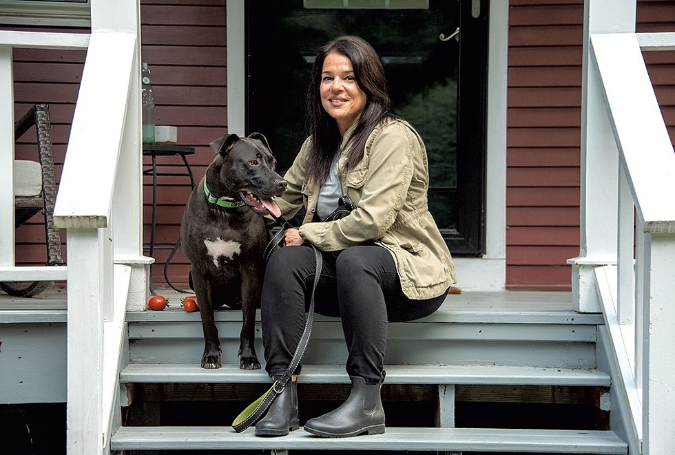 Brenna Galdenzi with her dog, Snoopy, at her home in Stowe - JEB WALLACE-BRODEUR