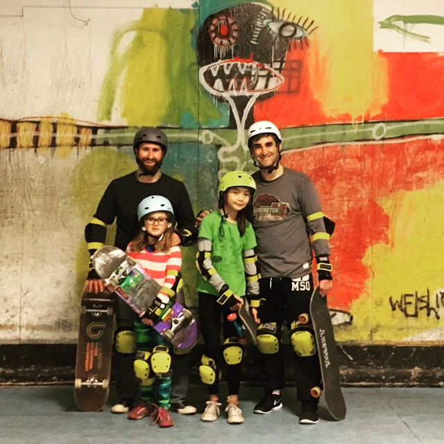 Parks director Jesse Bridges, left, and Mayor Miro Weinberger get a skateboarding lesson with their daughters. - COURTESY OF THE MAYOR'S OFFICE
