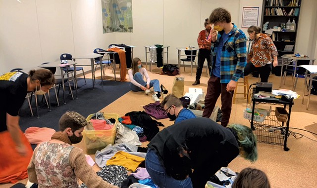 Students sorting dresses before the Seawolves Drag Ball Halftime Show - COURTESY OF ANDREW LEVALLEY