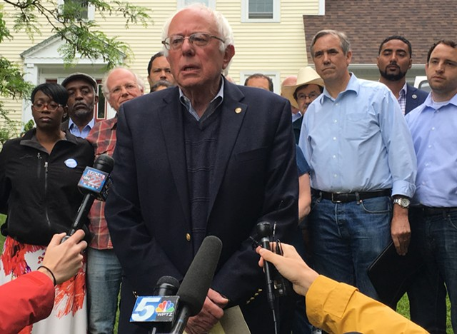 Sen. Bernie Sanders addresses reporters Sunday outside his Burlington home. - PAUL HEINTZ