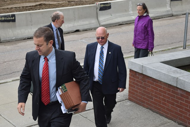 Defense attorney Brooks McArthur and Sen. Norm McAllister arrive at court Monday in St. Albans. - TERRI HALLENBECK